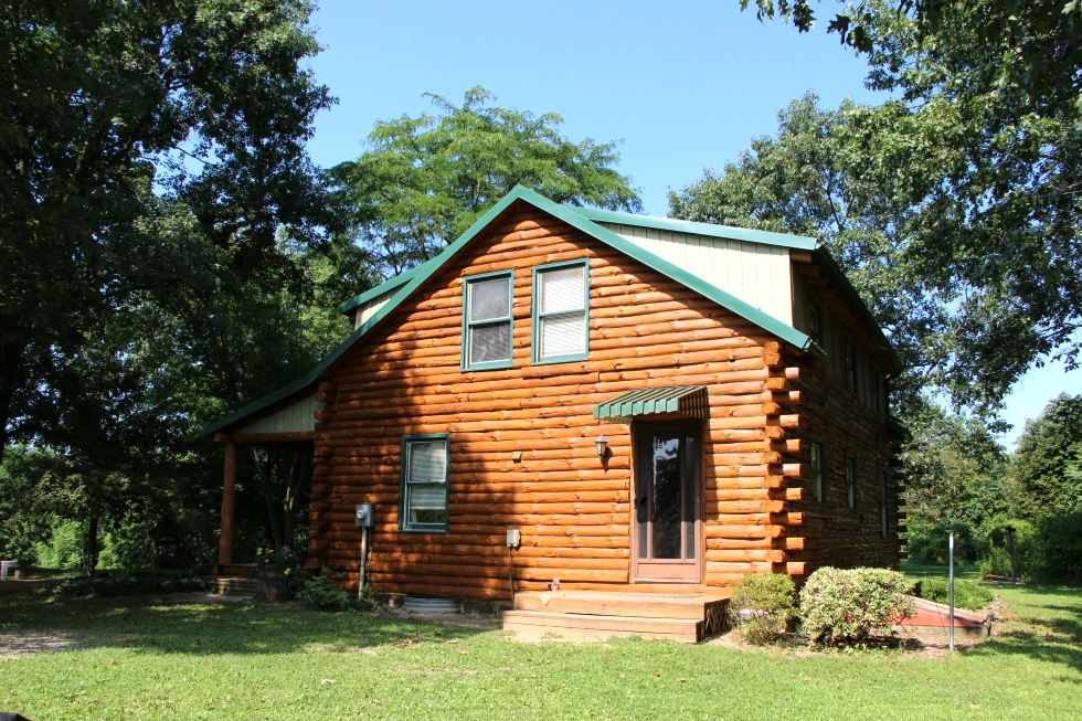 Log Cabin Staining by the LogDoctors Log Cabin Staining